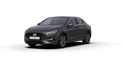 Front side view of the new Hyundai i30 Fastback in the colour Dark Knight.