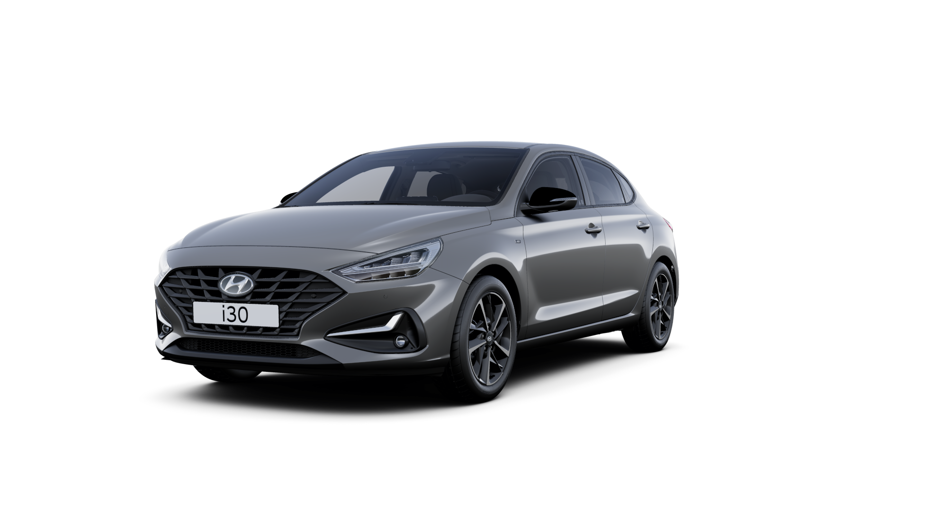 Front side view of the new Hyundai i30 Fastback in the colour Amazon Grey.